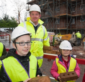 Chris Wylde (Construction Site Manager) with Park View Primary pupils, Jake and Isla